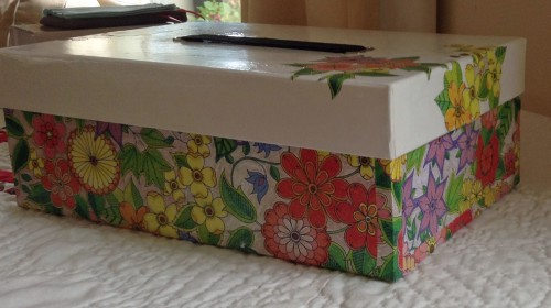 A box covered with a Johanna Basford design from the Secret Garden that I coloured in.